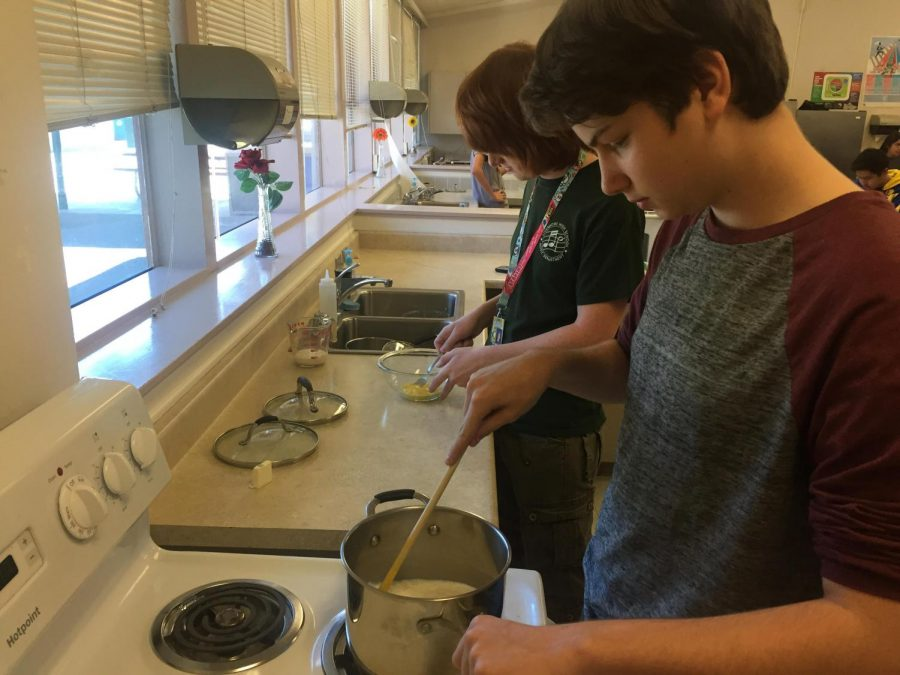 Foods 1 students make rice pudding.