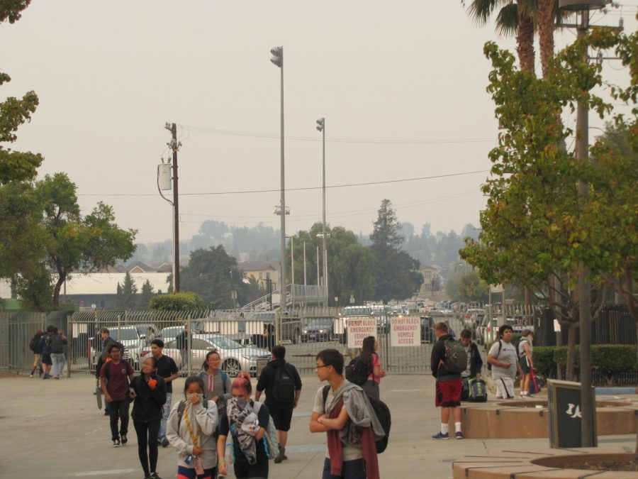 LHS+students+hold+clothing+over+their+faces+after+school+on+Nov.+9+as+smoke+from+the+Camp+Fire+and+other+regional+wildfires+in+California+darkened+the+skies+over+Livermore.+