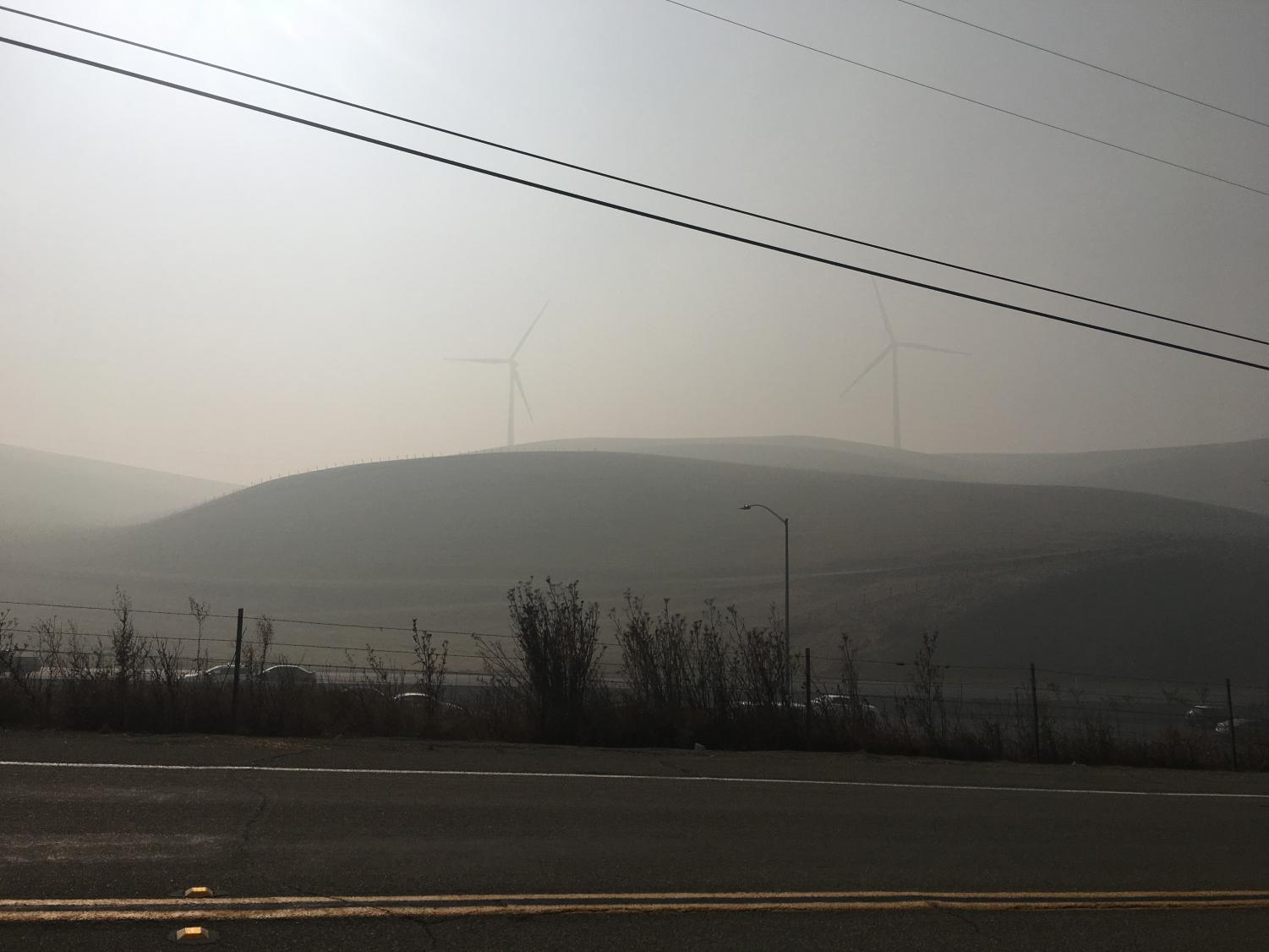 Smoke fills the air around the Altamont Pass, obscuring the iconic hills and windmills on the way into Livermore.