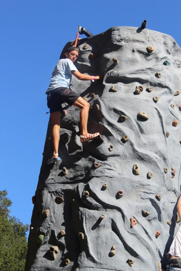 Gage Rohrbacher conquering the rock climbing wall.